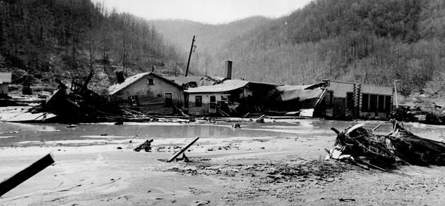 """February 26, 1972:  A Pittston Coal Company's coal slurry impoundment dam collapses in Logan County, West Virginia, and 138 million gallons of black waste water and sludge pours into the Buffalo Creek valley below, killing 125 and injuring over 1,100 people.  In its legal filings, the company referred to the accident as """"an Act of God."""""""