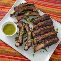 Beef Back Ribs marinated in chimichurri and then roasted on your grill.  Set ups shown for kamado grills (Big Green Egg, etc), regular charcoal grills, and gas grills (Char-Broil, etc)