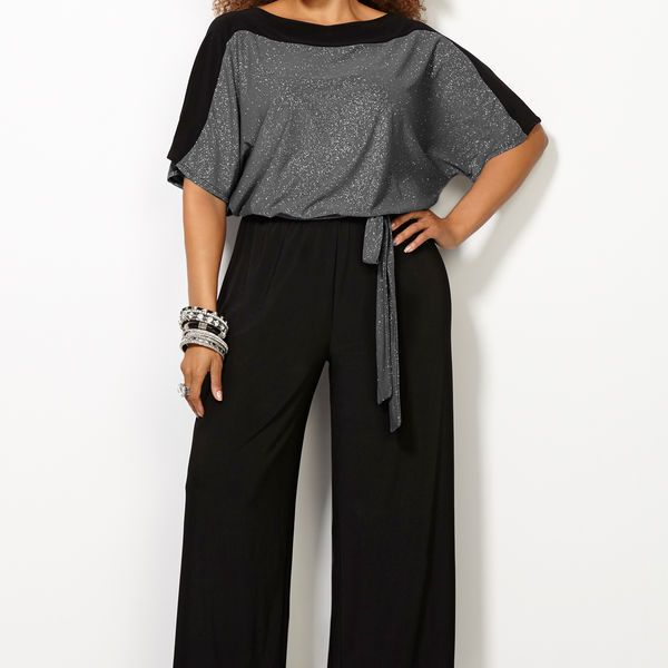 I can't believe this is a jumpsuit for REAL plus size but done in, I think a clever & classy way because it gives true definition of the waist.