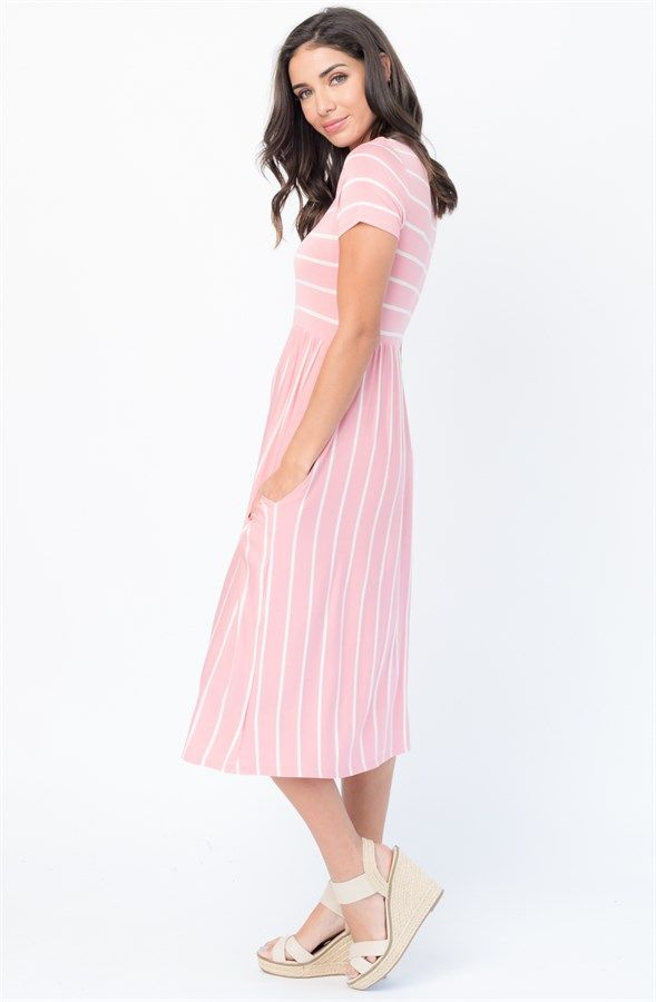 A charming everyday must-have. With its flattering everyday silhouette, leg lengthening look, mixed in with classic stripes, this soft jersey design combines the ease of a tee in dress form. Available in 4 colors: Black Heather Grey Pink Denim This garment runs true to size: Small 0-4 Medium 6-8 Large 10-12 X-Large 14-16
