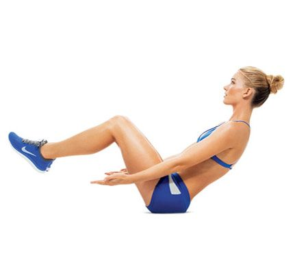 The 23-Minute Lunchtime Workout: Minutes 8 to 15. Move 3: Work lower back, abs and hips with the V-Up. Lie faceup, legs extended, feet 3 inches off floor, arms at sides, palms up. Bend knees and crunch up until abs engage (as shown). Hold for 1 beat, then return to start; repeat. Do 7 reps. #SelfMagazine