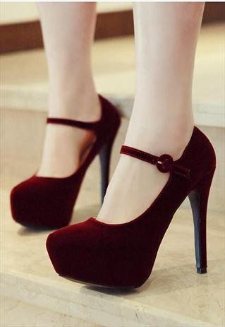 red velvet platform heels.....I really want a pair of these! All that's missing is a Fishnets and a whip with a black sexy dress and then you toss on a British Accent and become someone else!!!