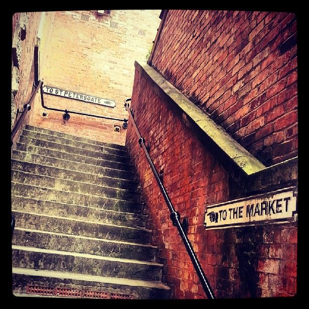 Very old steps leading up to Stockport market, Manchester, England, United Kingdom, 2013, photograph by Martyn Johnson.