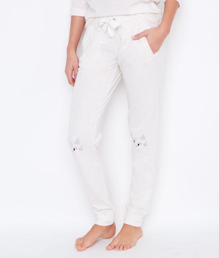 Pantalon uni, imprimé chaton aux genoux
