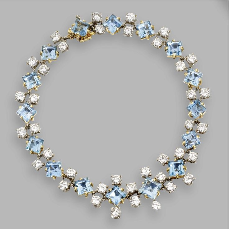 AQUAMARINE AND DIAMOND BRACELET, CARTIER, CIRCA 1940 Set with 16 square-cut aquamarines, accented by 38 round diamonds weighing approximately 6.10 carats, mounted in palladium and gold, length 7¼ inches, signed Cartier, numbered FALL44-58710.