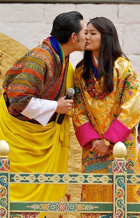 King Jigme Khesar Namgyel Wangchuck and Queen Ashi Jetsun Pema Wang The Bhutanese royals kiss in front of 50,000 well-wishers on the final day of their wedding celebrations in Thimphu on 15 October 2011.