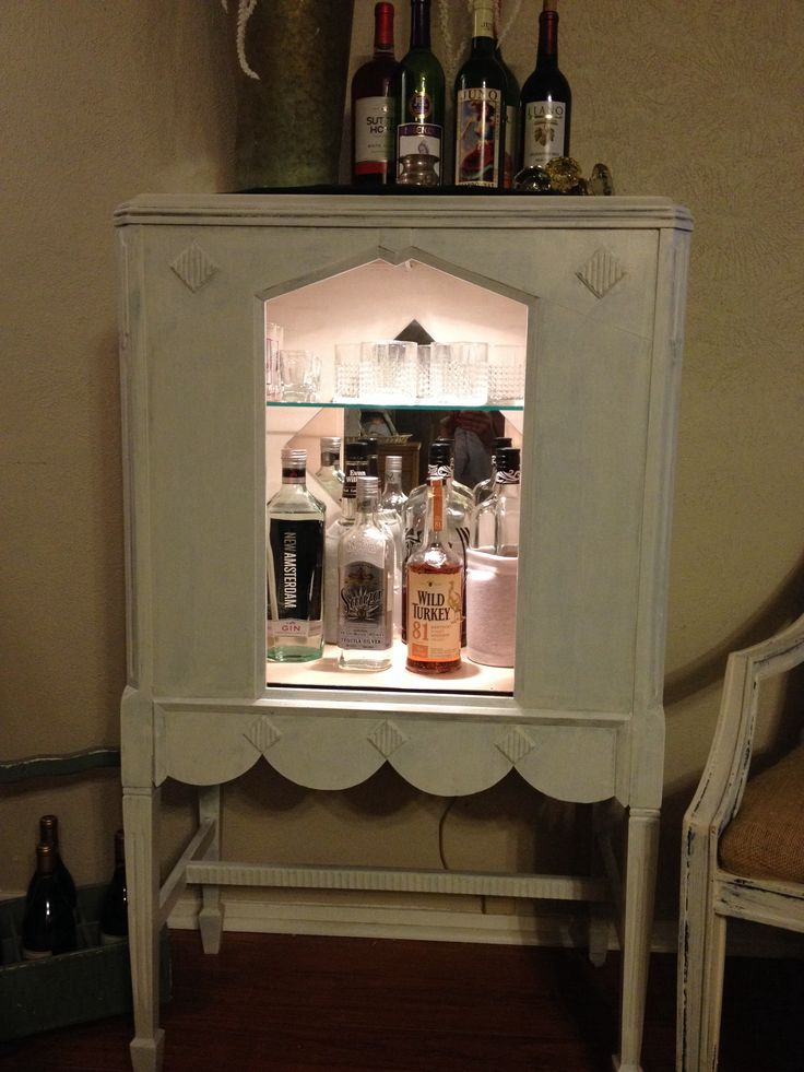 I took an old radio console and turned it into a shabby chic liquor cabinet! Love