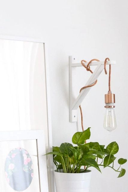 Skip The Floor Lamp Proper lighting is very important in a small apartment, but a floor lamp can be a bit of a burden. This cool DIY helps lighten up your room and leave more space free.