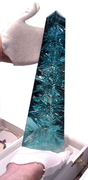 Dom Pedro Aquamarine - The world's largest cut and polished aquamarine. Housed in the permanent collection of the Houston Museum of Natural Science. The finished piece is nearly 14 in tall and weighs 10,363 carats, or about 5 lbs.