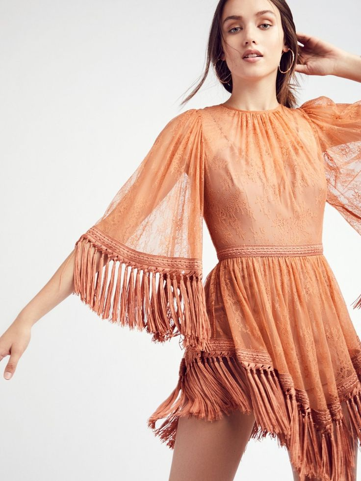 Are You Ready Girl Mini Dress   Delicate lace mini dress featuring a featured waist and flared sleeves.    * High neck silhouette   * Statement fringe trim   * Romper slip   * Hidden back zip