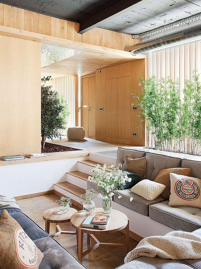Sunken living room in the Barcelona Loft Exclusive Industrial Loft in Barcelona Invites Nature Indoors!