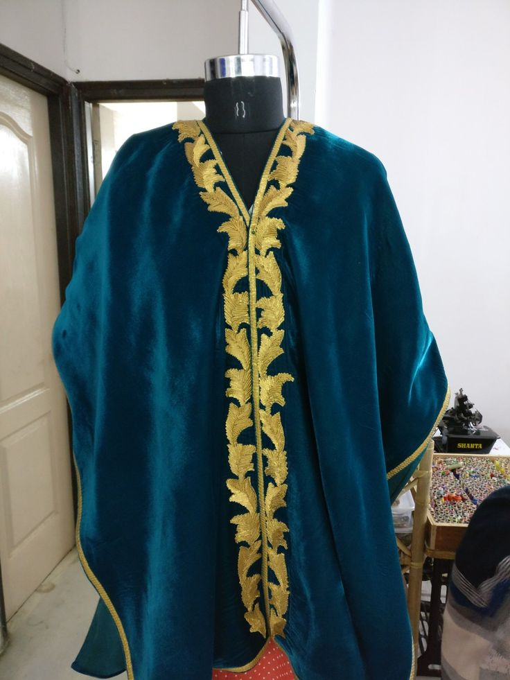 Velvet cape with embroidery.