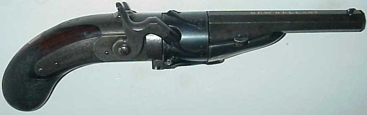 """Hand built revolver by V. G. W. Libeau, New Orleans, 1847. made without serial #, cal. .34 percussion, 4 11/16"""" octagonal barrel with dove-tailed front-sight and flush gold inlaid on top flat NEW ORLEANS. 12-groove-rifling with rapid twist, lock-plate engraved in script as pictured. 1 15/16"""" five-shot cylinder with unusual individual countersunk spring system, applying pressure an each nipple and allowing incorrect size percussion caps. Forward of cylinder periphery over each chamber and…"""