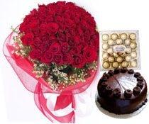 A Hamper Of 50 Red Roses 24 Ferrero Rocher Chocolates 1/2 Kg Cake.