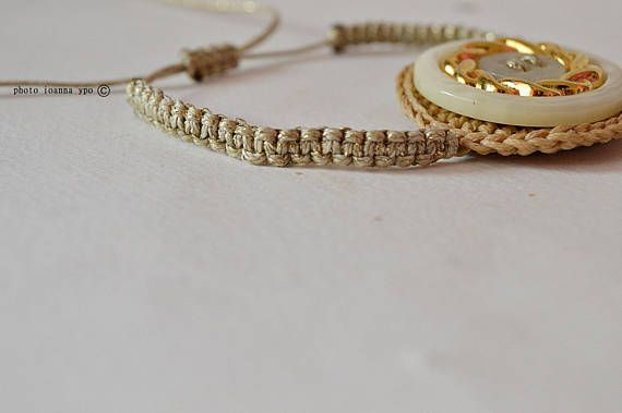 Crochet beige circle with gold and white button macrame