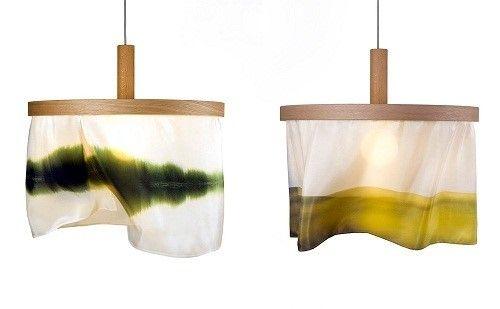 挪威设计师Nicolette Brunklaus用橡木和丝绸制作的吊灯,飘逸的丝绸灯罩上印染着倒影在松恩湖(Sognsvann)的婆娑树影。
