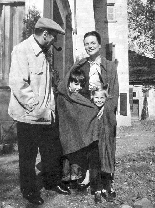 Simenon, his wife and children, get ready to leave for their daily walk in the country.