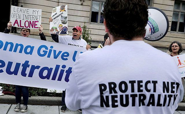 Proponents of net neutrality protest against Federal Communication Commission Chairman Ajit Pai outside the American Enterprise Institute before his arrival May 5, 2017 in Washington, DC. (Photo: Chip Somodevilla / Getty Images)