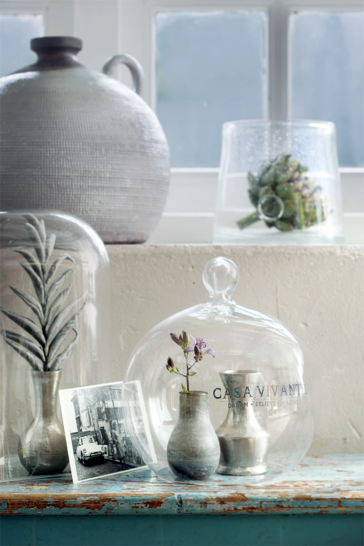 covers with small vases, precious photos and pretty flowers & green leaves
