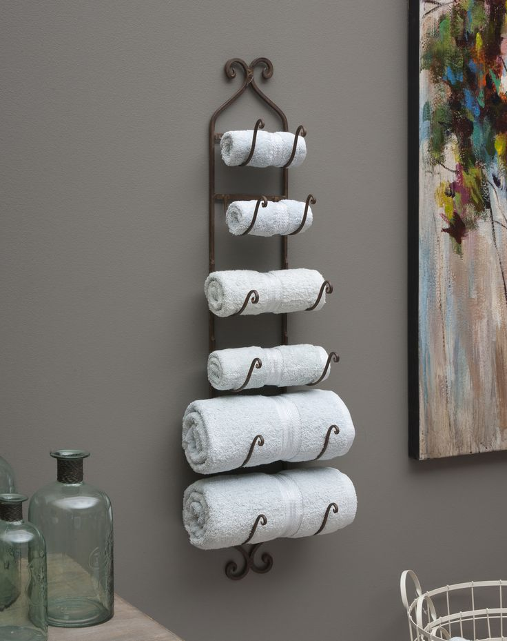 This unique metal wall rack is extremely versatile. Perfect in the kitchen for organizing utensils, great in the bar to hold a collection of wine bottles and perfect in the bathroom to display hand and bath towels.