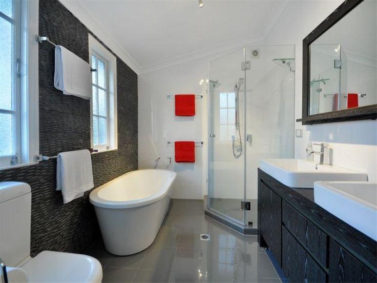 bathrooms image: blacks, whites - 255501 Stone textured wall, freestanding bath, black wood grain cabinet, corner shower
