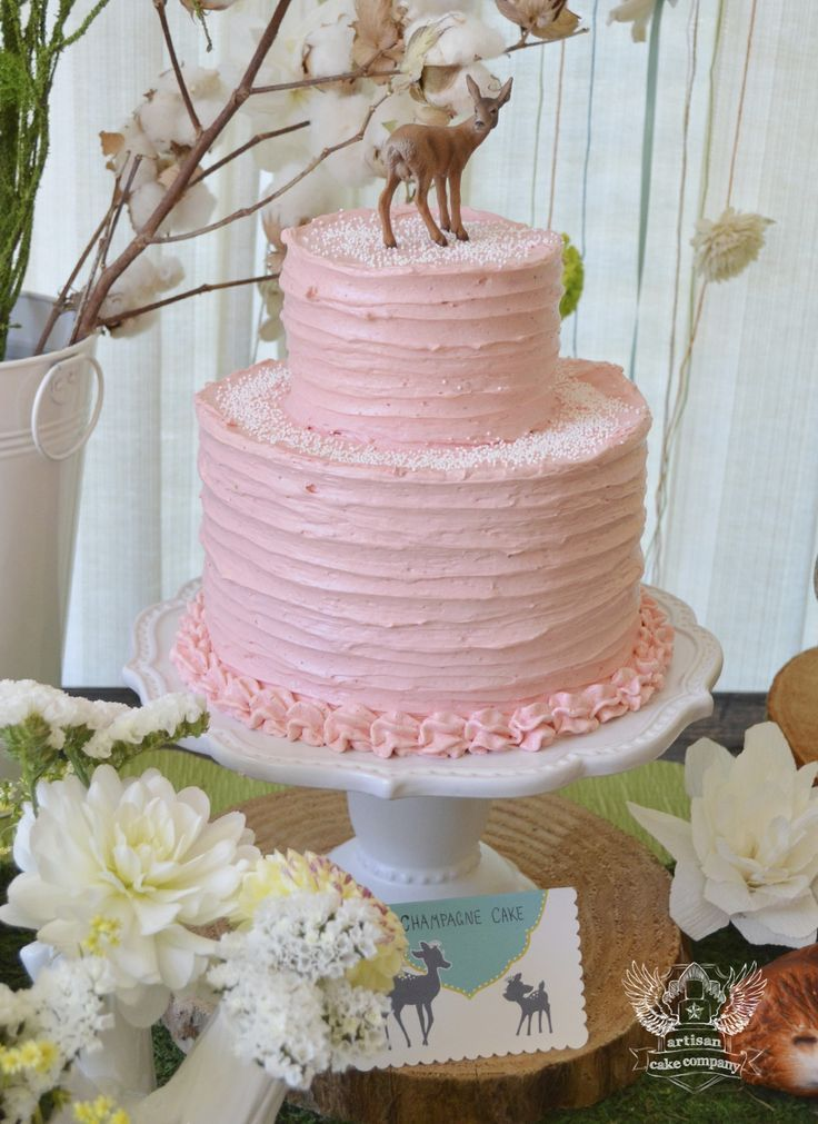 A simple pink cake for a woodland themed birthday party or ...