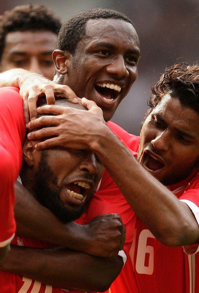 UAE team celebrate after scoring over Uruguay in Mens Soccer