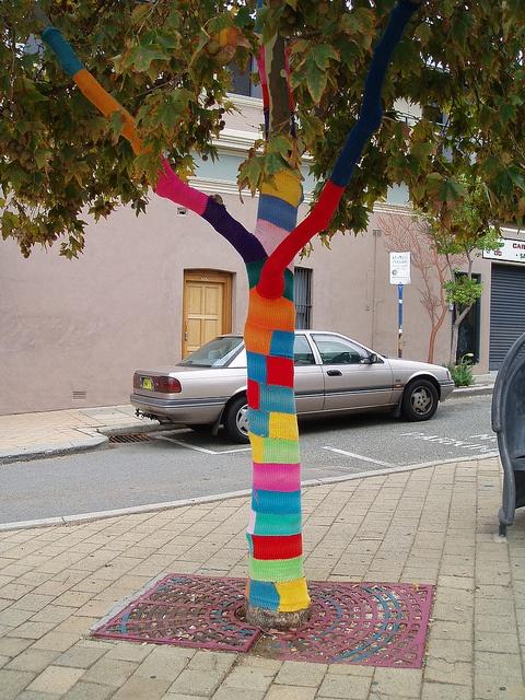 Guerilla Knitting / Yarn bombing outside the Wild Poppy Cafe, Australia by Figgles1, via Flickr
