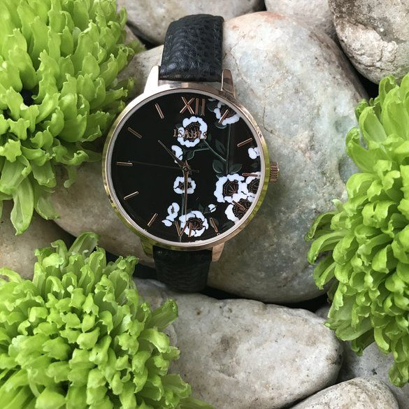 ISABIS WATCH | Hello Pretty. Buy design. japanese flowers on the dial of an ultra-cute watch, exemplifying ISABIS's nature-inspired whimsy and charm.A high-polish rose gold-plated case and floral print dial amp the feminine appeal of a beautiful round watch paired with a black pineapple vegan leather strap.