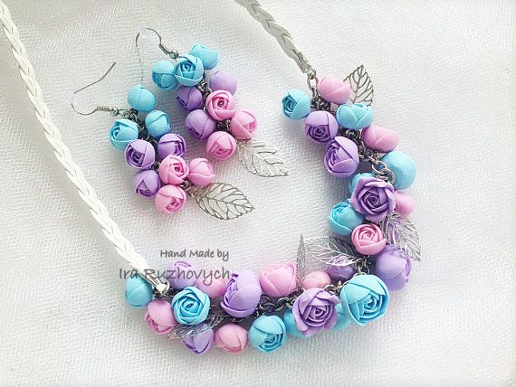 The flower is made from polymer clay, all flowers I make myself.  The necklace size is adjustable between 45cm - 50cm.  If you would like the