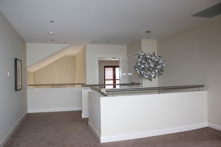 this is the light they have used in displ home above stairs and larger version in foyer....