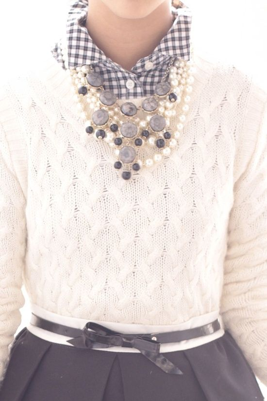 Very cute, simple outfit with big beaded necklace to add flair. Love the plaid collar under the knit.