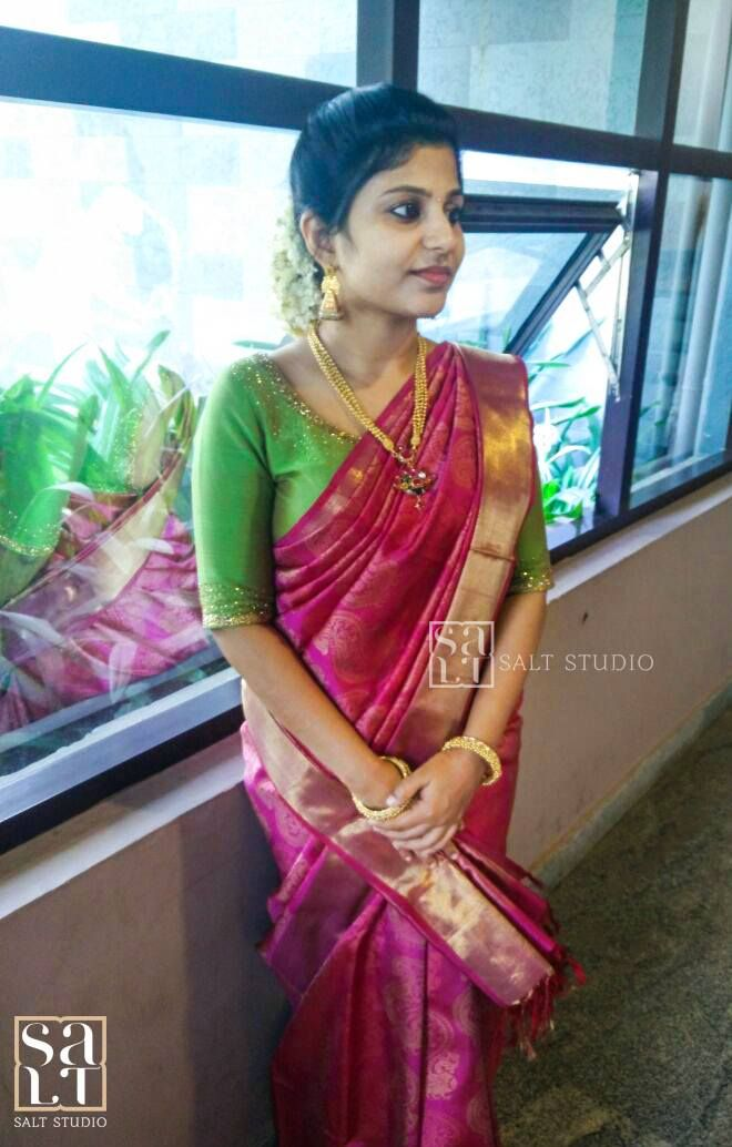 Here s a colour combination that can never go wrong - a deep pink  kancheevaramSaree teamed with a bright green embroidered blouse. Our  model  is our lovely client  Aswathy. We love her ethnic splendour!  embroidery  sarees  kanjeevaram  designer  saltstudio  kochi  happyclient  15 January 2017