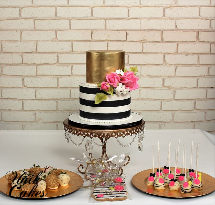 "Kate spade inspired birthday cake and dessert table.  The cake was decorated in gold and white and black stripes along with pink roses. We also made matching cake pops, chocolate covered strawberries and Kate spade inspired cookies as favors, decorated in black and white stripes with pink roses and golden ""Thank You""."