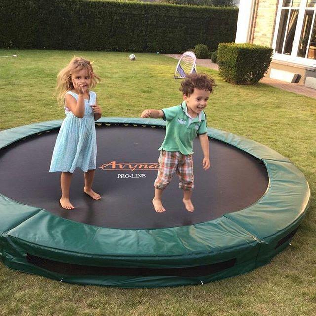 Happy kids #jumping on the #Avyna #InGround #trampoline - Share the Fun  #trampolines #proline #ingroundtrampoline #groundleveltramp #groundleveltrampoline #sunkentrampoline #ingraaftrampoline #inflatables #soccergoals #footbalgoals #buitenspelen #buitenleven #tuintrampoline #kinderen #tuinieren