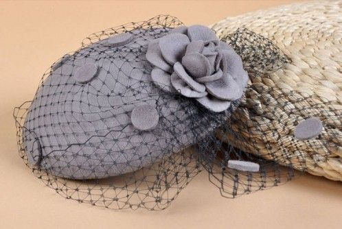 """Charlotte"" Grey Fascinator A cute and quirky wool felt hat, designed to be worn slightly tipped with lace net detail that is swept to the side and featuring a matching felt flower. The hat and net are also dotted with matching felt circles. Gorgeous! $79.95 including gift box and FREE shipping in Australia."