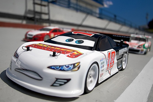Gas Whole at the Track | This is my X-Ray '007, 10th scale, electric on-road, touring race car. After watching 'Cars' and seeing my sons enthusiasm for all that's related, I designed a paint and logo scheme then applied it to a Mohawk lexan body.
