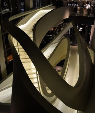 Armani Store, New York City  The Manhattan flagship, opened in 2009, occupies 43,000 square feet of prime Fifth Avenue real estate—enough room for a restaurant, a chocolate shop, numerous Armani collections, and this fabulous whirling staircase clad in white plastic. Designed by Doriana and Massimiliano Fuksas, it links four floors of suits, shoes, handbags, and yes, designer underwear. —Briana Fasone