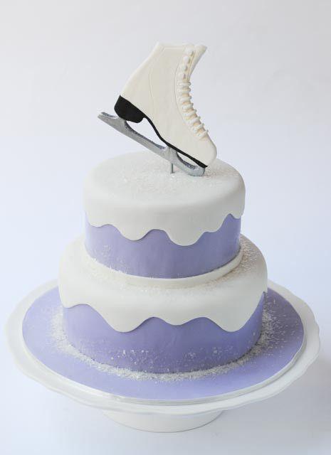 Ice skating cake.  Gumpaste skate, glitter snow, purple fondant.  Made by Cakes by Caralin.  www.cakesbycaralin.com