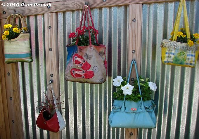"Unusual Garden Planters...Remember those old purses you found in a box in the darkest corner of the garage? The ones where you said to yourself ""What on earth was I thinking!?"" Now you know what do do with them."
