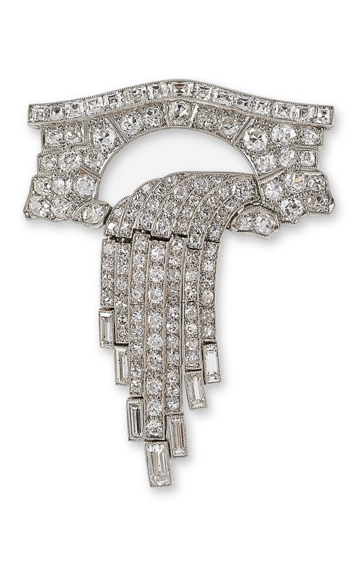 An Art Deco platinum and diamond waterfall brooch, English, Birmingham, circa 1930. The platinum brooch modelled with bright circular brilliant and step cut diamonds as a waterfall tumbling under a bridge, the falling water in articulated sections, all with mille-grained edging.