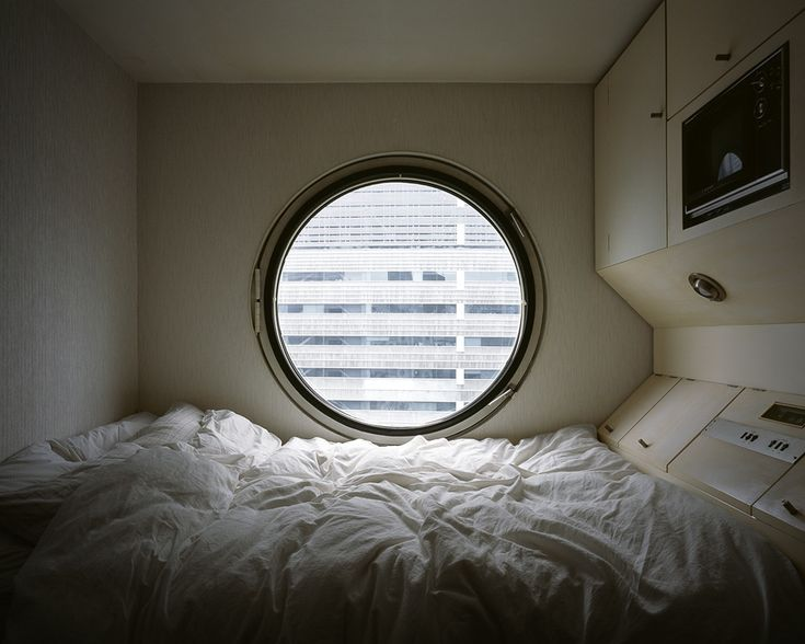 Stay at Tokyo's Nakagin Capsule Tower for only $30 a night - find out how on Interiorator.com - transmitting tomorrow's trends today.