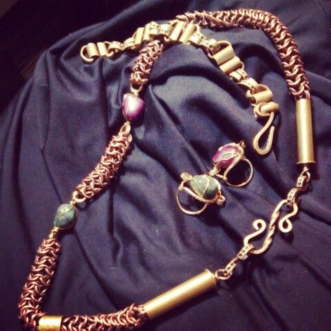 Antique copper weave with bullet casings,  emerald, ruby, gold rings and vintage brass chain link bracelet. By yours truly.