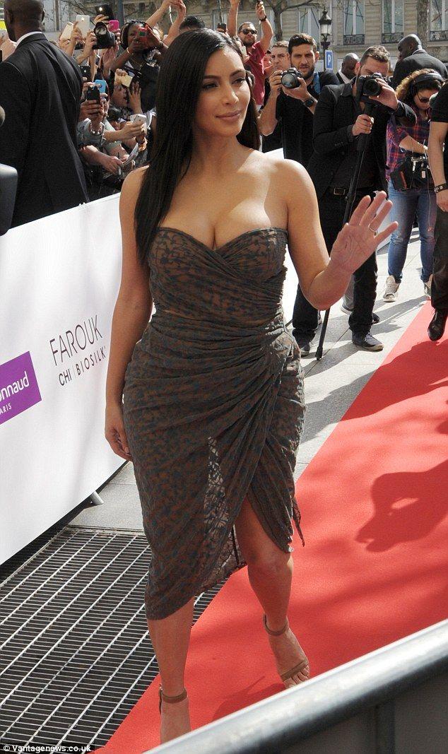 Kim Kardashian displays cleavage in semi-sheer dress at hair line launch in Paris