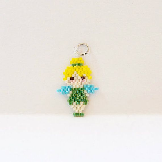 Whimsical fairy beadwork stitched with Miyuki Delica seed beads.    This mini fairy has been hand beaded in the brick stitch bead weaving method. Use