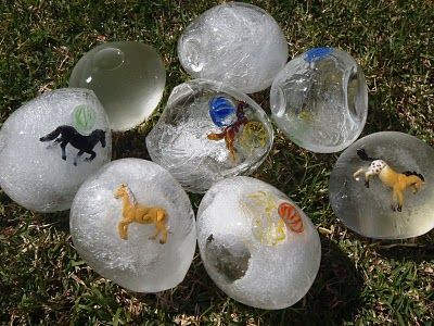 Freeze balloons filled with water and small toys. Cut balloon off and play with eggs outside. Provide spoons for cracking ice and digging treasures out.