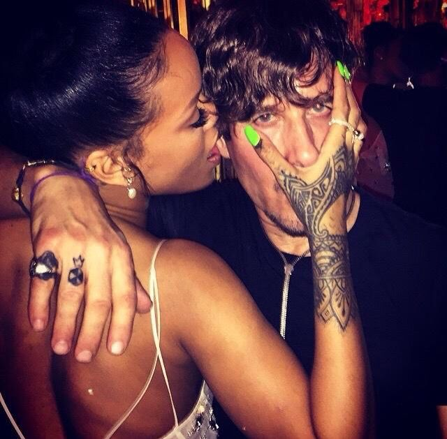 """Rihanna Was Seen Licking the Face of This Famous Fashion Photographer  Rihanna Was Seen Licking the Face of This Famous Fashion Photographer Advertisement Rihanna licks fashion photographer Steven Klein's ear in this sexy photo posted to his Instagram account.  """"Me+Rhianna being Naughty at the British Fashion Awards @studiodawidhorlando"""" Steven captioned the photo, which was taken at this past week's 2014 British Fashion Awards."""