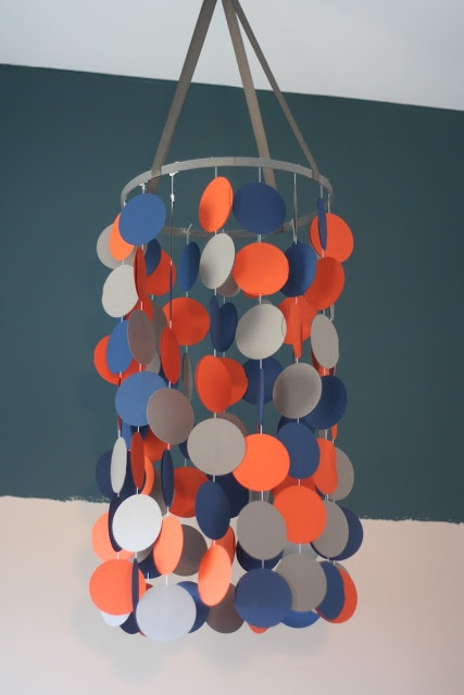 DIY circle mobile for baby's nursery (would be so cute with my scalloped punch! maybe some paint chips?)