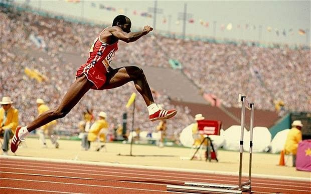 Edwin Moses - Undefeated for 9 years, 9 months, 9 days.   Chopped between the barriers with 13 rather than the conventional 14 steps, as he amassed an unprecedented sequence of 107 finals unbeaten....but more importantly, just look how far from the hurdle he's taken off!  Insane...