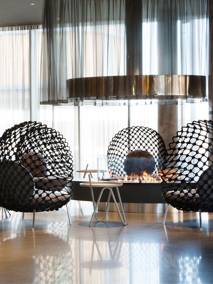 Black Chairs - Fireplace - Comfort Hotel Bergen Airport